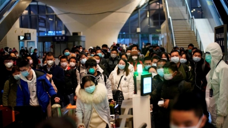 People-wearing-face-masks-arrive-at-a-railway-station-in-Wuhan-on-the-first-day-of-inbound-train-services-resumed-following-the-novel-coronavirus-disease-COVID-19-outbreak.JPG